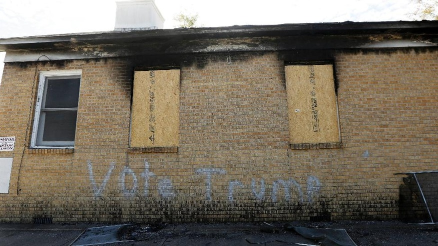 Boarded windows align Hopewell Missionary Baptist Church in Greenville, Miss., Tuesday, Nov. 22, 2016, after it was burned and vandalized three weeks ago. The First Baptist Church of Greenville has offered their church to the Hopewell congregation. (AP Photo/Rogelio V. Solis)