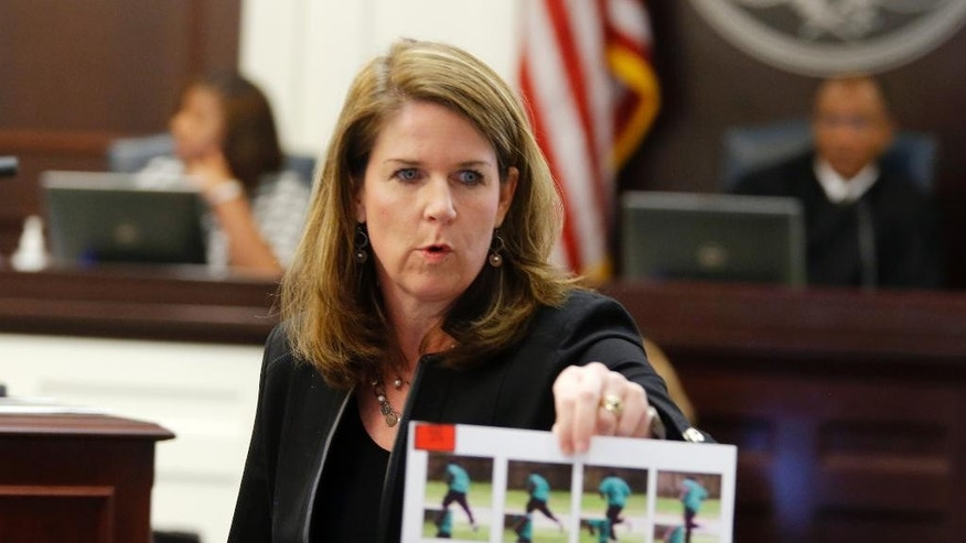 Ninth Circuit Solicitor Scarlett Wilson shows photos during the murder trial of former North Charleston police officer Michael Slager at the Charleston County court in Charleston, S.C., Wednesday, Nov. 23, 2016. (Grace Beahm/Post and Courier via AP, Pool)