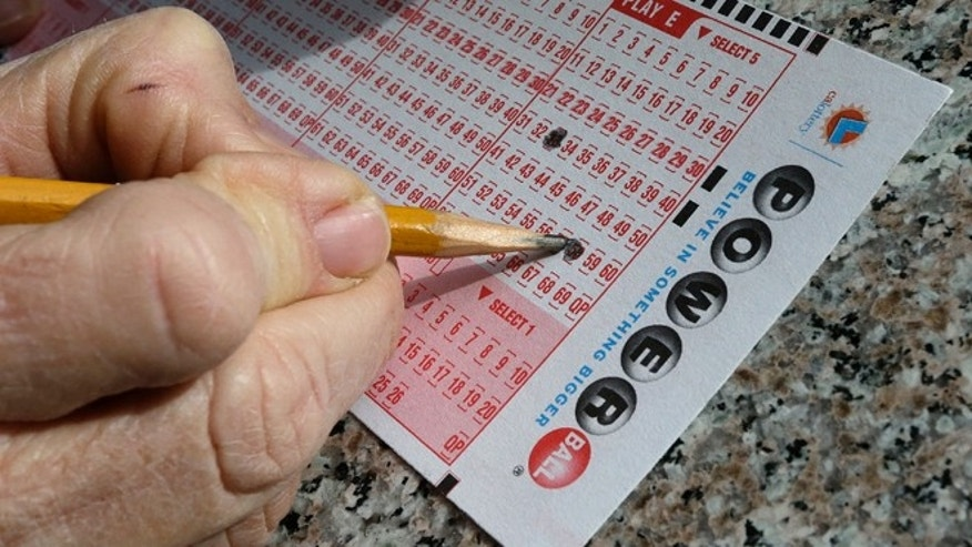 A lottery player fills out numbers on a powerball form Tuesday, Jan. 12, 2016, in Oakland, Calif. The Powerball jackpot has grown to over 1.5 billion dollars. (AP Photo/Ben Margot)