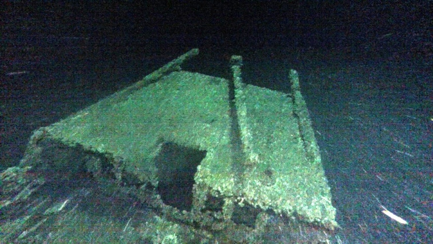 "In this undated photo provided by Roger Pawlowski, the cabin and tiller of the ""Black Duck"" is shown in 350 feet of water off Oswego, N.Y. Underwater explorers say they've found the 144-year-old Lake Ontario shipwreck of the rare sailing vessel that typically wasn't used on the Great Lakes. Underwater explorer Jim Kennard says the Black Duck is believed to be the only fully intact scow-sloop to exist in the Great Lakes. (Roger Pawlowski via AP)"