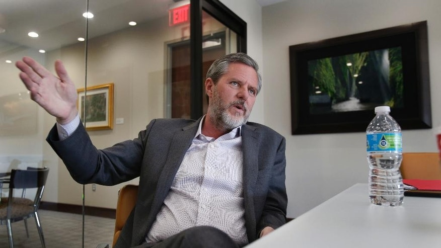 In this Wednesday, Nov. 16, 2016 photo, Liberty University president Jerry Falwell Jr., talks during an interview in his offices at the school in Lynchburg, Va. Falwell Jr. enthusiastically endorsed Donald Trump in January. As Liberty University grew from a tiny Baptist college into a touchstone institution for evangelicals, it also became a hub of conservative politics, a revolving door of politicians and their surrogates courting young voters. But this year, the campus was in the spotlight for another reason: a rift caused by Donald Trump's candidacy that raised questions about the college president's influence, open discourse, and practicality versus principles in choosing a candidate. (AP Photo/Steve Helber)