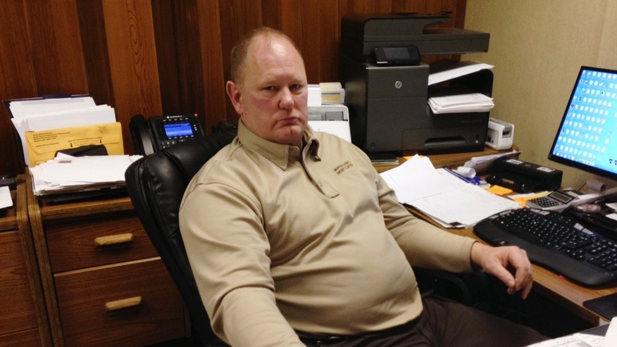 Morton County Sheriff Kyle Kirchmeier looks up from his desk in Mandan, N.D.