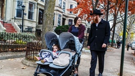 In this Friday, Nov. 25, 2016, photo provided by Chabad.org, Rabbi Mendel Alperowitz, walks with his wife, Mussie, and daughters in the Brooklyn borough in New York. The Alperowitzes will open a Chabad House in the coming weeks in Sioux Falls, S.D., that will offer religious education, worship services and other programs. (Eliyahu Parypa/Chabad.org via AP)