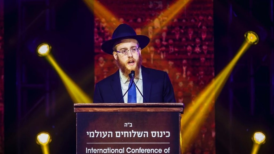 In this Sunday, Nov. 27, 2016 photo provided by Chabad.org, Rabbi Mendel Alperowitz speaks at the International Conference of Chabad-Lubavitch Emissaries in the Brooklyn borough of New York. Alperowitz and his wife, Mussie, will open a Chabad House in the coming weeks in Sioux Falls, S.D., that will offer religious education, worship services and other programs. (Eliyahu Parypa/Chabad.org via AP)