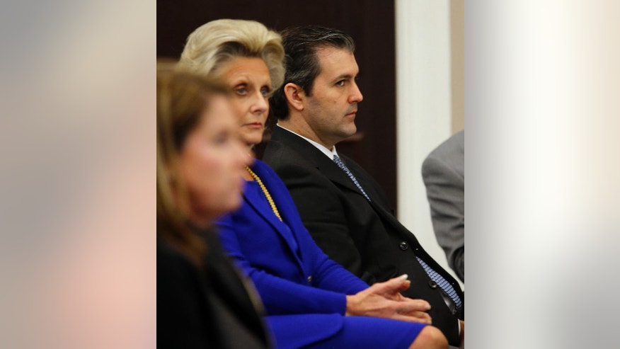 Former North Charleston police officer Michael Slager, right, listens during his murder trial at the Charleston County court in Charleston, S.C., Monday, Nov. 28, 2016. A judge is considering whether jurors will visit the spot where a white former South Carolina police officer is accused of shooting and killing an unarmed black man in North Charleston. (Grace Beahm/Post and Courier via AP, Pool)