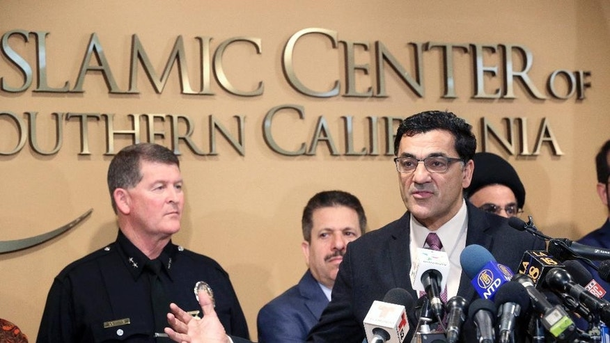 Salam Al-Marayati, president of the Muslim Public Affairs Council, speaks as Los Angeles Police Deputy Chief Michael Downing listens, left, during a news conference at the Islamic Center of Southern California in Los Angeles, Monday, Nov. 28, 2016. Government officials have condemned a hate-filled letter received by several California mosques that said Muslims would be exterminated by President-elect Donald Trump. Downing said that Los Angeles police are investigating two letters received by mosques in the city as a hate incident, but not a crime at this point. (AP Photo/Nick Ut)