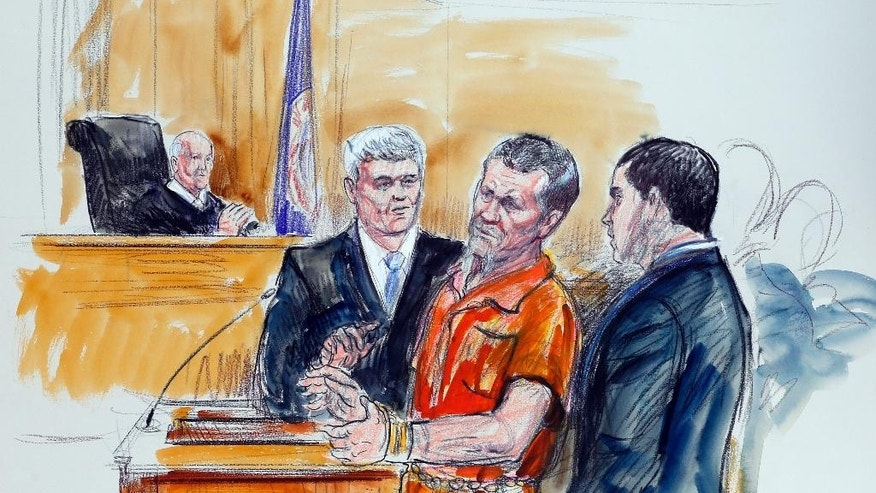 FILE- This Nov. 7, 2014, artist rendering shows, Irek Hamidullin, front center, his attorney Robert Wagner, front left, and interpreter Ihab Samra, front right, as Judge Henry Hudson, left, listens in Federal Court in Richmond, Va. Two years after being sent to the United States to face charges in an attempted attack on American forces in Afghanistan, Irek Hamidullin  is arguing he should never have been prosecuted at all. (AP Photo/Dana Verkouteren, File)