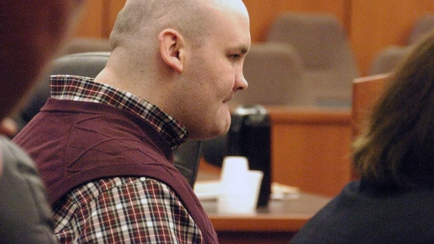 FILE - This April 17, 2015 file photo shows Michael Keith Spell in state District Court in Sidney, Mont. A defense attorney says Spell, a mentally-disabled Colorado man serving a 100-year prison term in a Montana teacher's murder, should be transferred to the custody of state mental health officials. Attorney Wendy Holton said in an appeal brief filed Tuesday, Nov. 29, 2016 that Spell needs treatment that he won't receive in prison. Spell's 2012 killing of Sherry Arnold in the once-quiet town of Sidney highlighted a significant spike in crime following an oil boom that's swept the Northern Plains. (AP Photo/Matthew Brown, File)