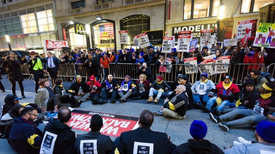 A crowd of 350 people protest in front of a McDonald's in New York for a #15 minimum wage