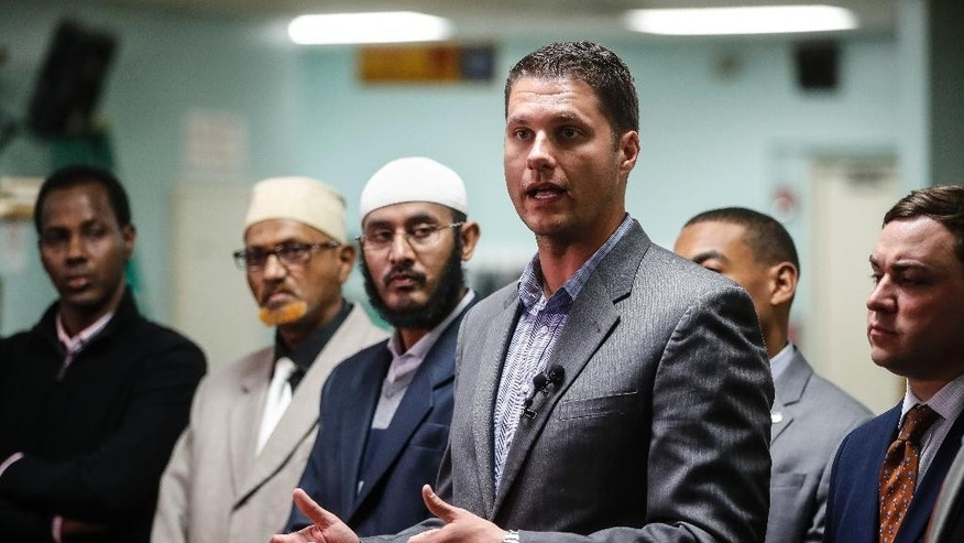 Columbus City Council president Zach Klein speaks alongside muslim faith leaders at the Ibnu Taymaya Masjid & Islamic Center during a news conference, Tuesday, Nov. 29, 2016, in Columbus, Ohio, following an attack at The Ohio State University campus the previous day. Investigators are looking into whether a car-and-knife attack at Ohio State University that injured several people was an act of terror by a student who had once criticized the media for its portrayal of Muslims. (AP Photo/John Minchillo)
