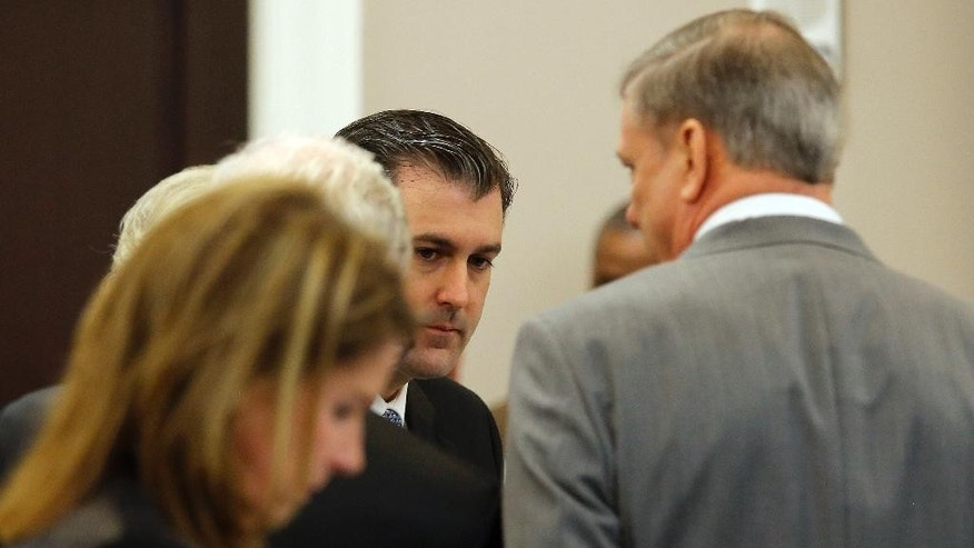 Former North Charleston police officer Michael Slager, center, listens during his murder trial at the Charleston County court in Charleston, S.C., Monday, Nov. 28, 2016. A judge is considering whether jurors will visit the spot where a white former South Carolina police officer is accused of shooting and killing an unarmed black man in North Charleston. (Grace Beahm/Post and Courier via AP, Pool)