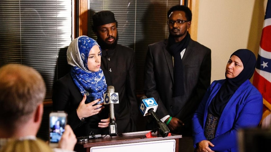 Roula Allouch, board chair of the Council On American-Islamic Relations, left, speaks during a news conference regarding an earlier attack at the Ohio State University campus, Monday, Nov. 28, 2016, in Dublin, Ohio. A Somali-born Ohio State University student plowed his car into a group of pedestrians on campus and then got out and began stabbing people with a knife Monday before he was shot to death by an officer. (AP Photo/John Minchillo)