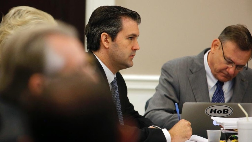 Former North Charleston police officer Michael Slager listens during his murder trial at the Charleston County court in Charleston, S.C., Monday, Nov. 28, 2016. A judge is considering whether jurors will visit the spot where a white former South Carolina police officer is accused of shooting and killing an unarmed black man in North Charleston. (Grace Beahm/Post and Courier via AP, Pool)