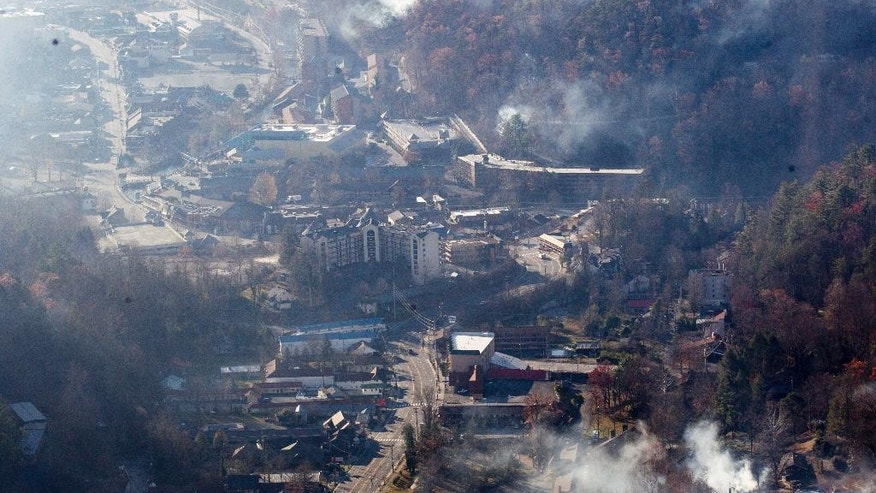 Burned structures are seen from aboard a National Guard helicopter near Gatlinburg, Tenn., Tuesday, Nov. 29, 2016. Thousands of people raced through a hell-like landscape to escape wildfires that killed several people and destroyed hundreds of homes in the Great Smoky Mountains. (AP Photo/Erik Schelzig)