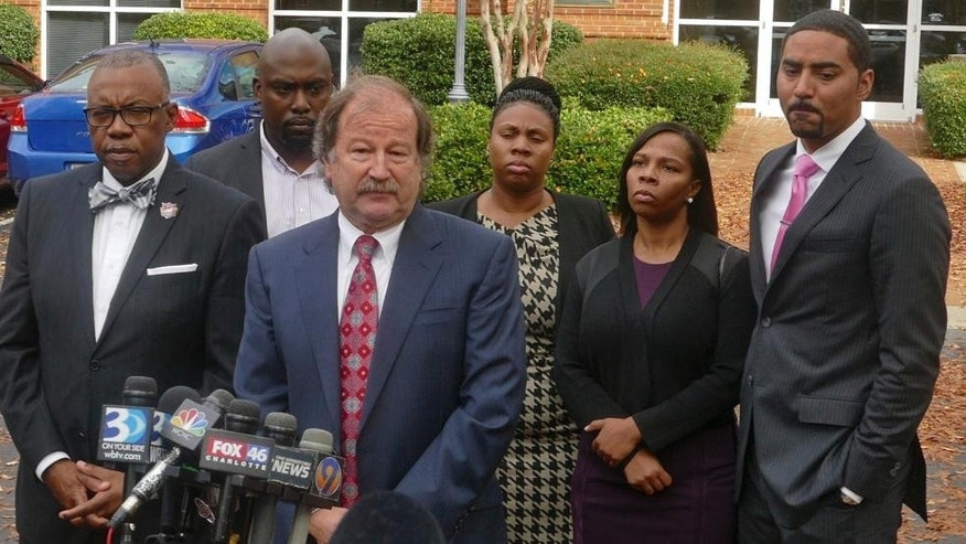 Attorney Charles Monnett speaks during a news conference with the family of Keith Lamont Scott after their meeting with Mecklenburg County District Attorney Andrew Murray Wednesday, Nov. 30, 2016 in Charlotte.  Murray announced  that the shooting by officer Brent Vinson was justified.  Vinson, who is black, shot and killed Keith Lamont Scott on Sept. 20.    (Davie Hinshaw/The Charlotte Observer via AP)