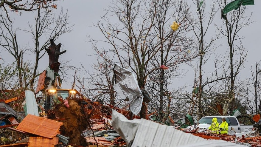 Workers start removing debris after a suspected tornado ripped through the town Wednesday, Nov. 30, 2016, in Rosalie, Ala. Storms that spawned deadly winds have dumped more than 2 inches of rain across much of north Alabama, causing floods after months of drought. (AP Photo/Butch Dill)