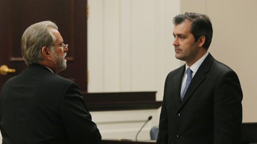 Deputy Solicitor Bruce DuRant, left, speaks to former North Charleston police officer Michael Slager during Slager's murder trial at the Charleston County court in Charleston, S.C., Tuesday, Nov. 29, 2016. Slager is charged with murder in the shooting death last year of Walter Scott. (Grace Beahm/Post and Courier via AP, Pool)