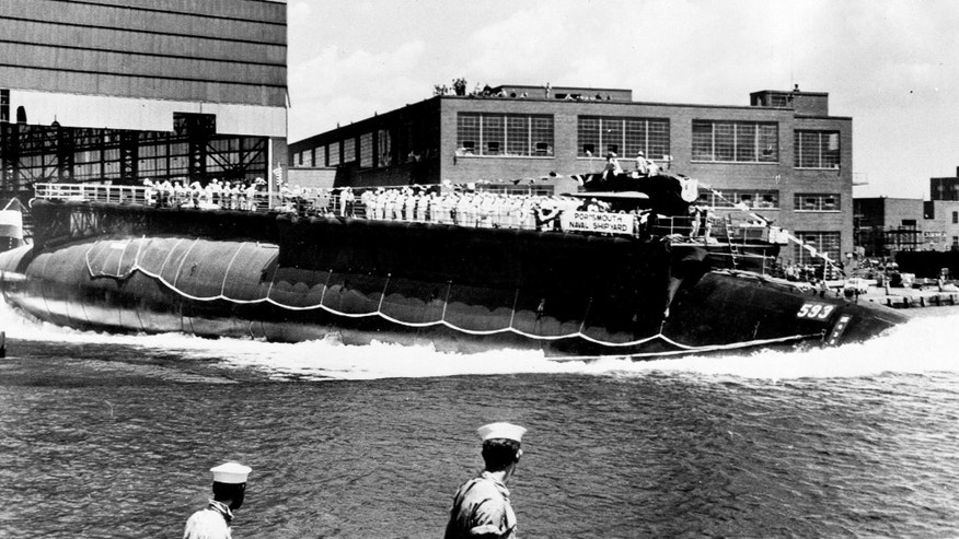 In this July 9, 1960 file photo the 278-foot (82 meters) long nuclear powered attack submarine USS Thresher, a first in its class boat, is launched bow-first at the Portsmouth Navy Yard in Kittery, Maine.