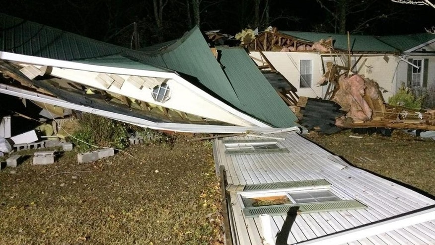 This Tuesday, Nov. 29, 2016 photo shows storm damage in the Arley area of Winston County, Ala. A suspected tornado killed multiple people in Alabama as a line of severe storms moved across the South overnight, authorities said. (Bill Castle/abc3340.com via AP)