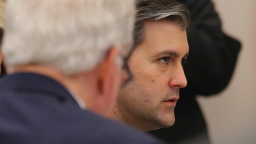 Former North Charleston police officer Michael Slager, right, sits in the courtroom during his murder trial at the Charleston County court in Charleston, S.C., Wednesday, Nov. 30, 2016. The case of a former South Carolina police officer charged with murder in the shooting death of an unarmed black motorist is now before the jury. (Grace Beahm/Post and Courier via AP, Pool)