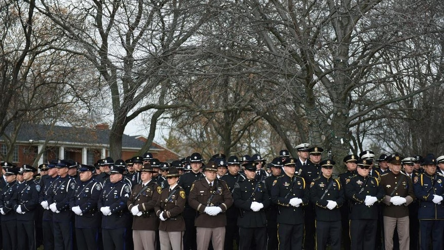 Hundreds of police officers line up to pay their final respects at the funeral of fallen Wayne State University Police officer Collin Rose held at St. Joan of Arc Catholic Church in St. Clair Shores, Mich., Thursday, Dec. 1, 2016. Rose was shot Nov. 22 as he tried to arrest DeAngelo Davis, who faces murder and gun charges. (Tanya Moutzalias/The Ann Arbor News via AP)