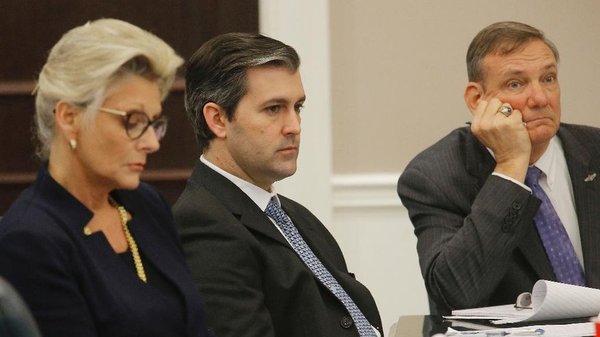 Former North Charleston police officer Michael Slager, center, sits in the courtroom during his murder trial at the Charleston County court in Charleston, S.C., Wednesday, Nov. 30, 2016. Closing arguments are underway in a South Carolina courtroom in the trial of a white former police officer charged with murder in the shooting death of an unarmed black motorist. (Grace Beahm/Post and Courier via AP, Pool)