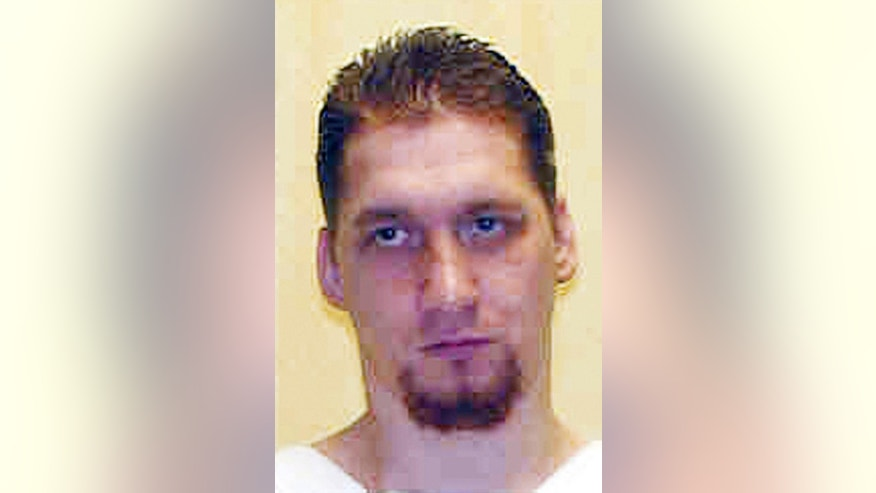 FILE – This undated file photo provided by the Ohio Department of Rehabilitation and Correction shows death row inmate Ronald Phillips, convicted of the 1993 rape and murder of his girlfriend's 3-year-old daughter in Akron, Ohio. Ohio Parole Board members are scheduled to hold a Thursday, Dec. 1, 2016, hearing to consider arguments for and against mercy for Ronald Phillips, the first inmate scheduled for execution under the state's revised lethal injection method that uses a three-drug combination. His execution is scheduled Jan. 12, 2017. (Ohio Department of Rehabilitation and Correction via AP, File)