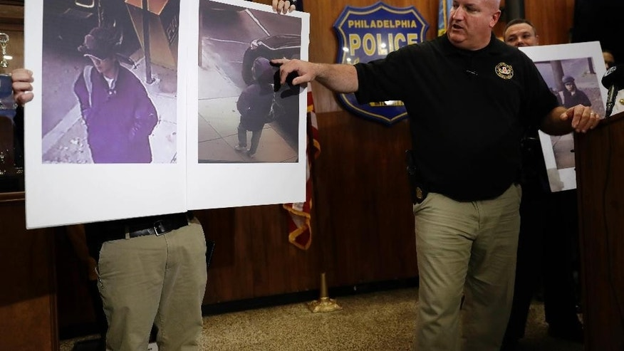 Philadelphia Police Det. Timothy Brooks discusses an image made from video of person of interest during a during a news conference at Police Headquarters in Philadelphia, Thursday, Dec. 1, 2016. Authorities have confirmed that a package that blew up when a Philadelphia man opened it contained a homemade explosive. They also announced Thursday that they have video of the person who dropped off the package at the home of 60-year-old James Alden, who was seriously wounded in the Nov. 22 blast. (AP Photo/Matt Rourke)