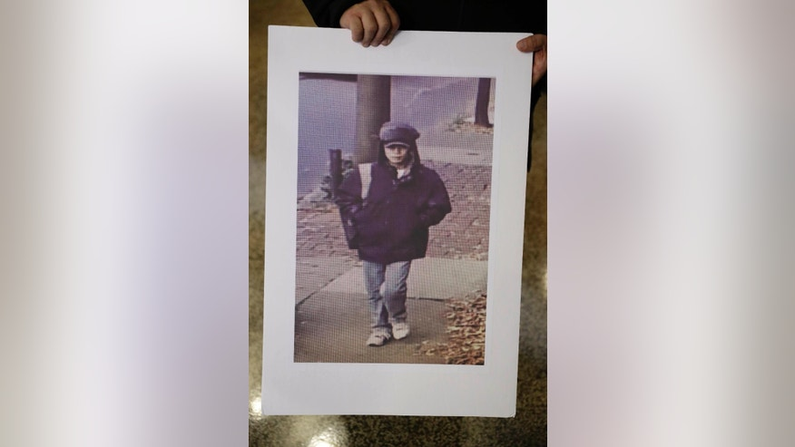 An image made from video of person of interest is displayed during a during a news conference at Police Headquarters in Philadelphia, Thursday, Dec. 1, 2016. Authorities have confirmed that a package that blew up when a Philadelphia man opened it contained a homemade explosive. They also announced Thursday that they have video of the person who dropped off the package at the home of 60-year-old James Alden, who was seriously wounded in the Nov. 22 blast. (AP Photo/Matt Rourke)