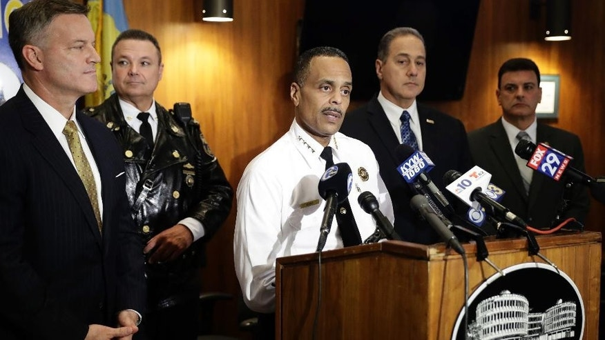 Philadelphia Police Commissioner Richard Ross Jr., center, speaks during a news conference at Police Headquarters in Philadelphia, Thursday, Dec. 1, 2016. Authorities have confirmed that a package that blew up when a Philadelphia man opened it contained a homemade explosive. They also announced Thursday that they have video of the person who dropped off the package at the home of 60-year-old James Alden, who was seriously wounded in the Nov. 22 blast. (AP Photo/Matt Rourke)