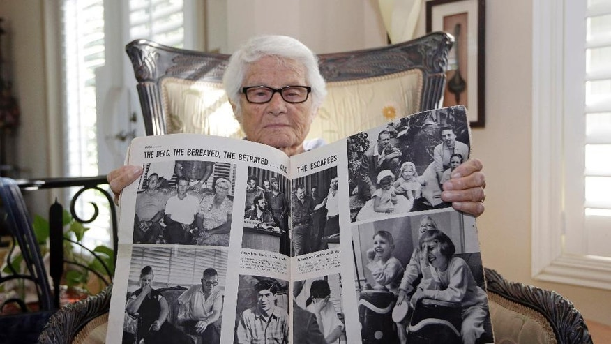 In this Tuesday, Nov. 22, 2016 photo, Frances R. Fuller displays a Life Magazine, from Oct. 31, 1960, with the photo, top left, of her parents William Fuller, left, Jennie Fuller, right, and her brother Robert Fuller, center, at her home in Miami. In 1960, Robert Fuller joined an ill-fated mission to lead a boatload of poorly trained Cubans from Miami in hopes of mustering up a counter-revolution on the island. Instead, the men were quickly captured, and Fuller confessed under torture to counterrevolutionary activities.  Fuller was sentenced to death by firing squad. The family asked to bring his body back with them to America. Castro's people said no. (AP Photo/Alan Diaz)
