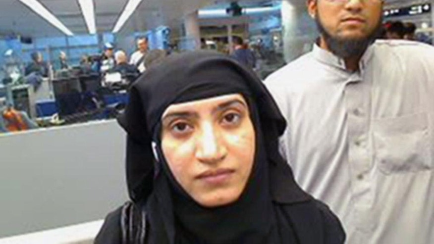 FILE - In this July 27, 2014 file photo provided by U.S. Customs and Border Protection shows Tashfeen Malik, left, and her husband, Syed Farook, at O'Hare International Airport in Chicago. In December 2015, San Bernardino County health inspector Farook and his Pakistan-born wife Malik opened fire on a meeting of Farook's colleagues, and were killed in a shootout with police. Investigators said the assailants were inspired by the Islamic State group. Victims' families and a Muslim community leader have spent the year since a terror attack in San Bernardino trying to counter what some feared would be a prolonged-hate-filled backlash. (U.S. Customs and Border Protection via AP, File)