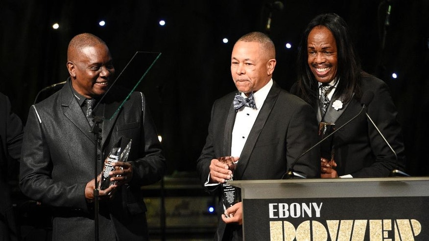 Honorees Philip Bailey, left, Ralph Johnson, center, and Verdine White of the band Earth Wind & Fire accept their awards at the 2016 EBONY Power 100 Gala at the Beverly Hilton on Thursday, Dec. 1, 2016, in Beverly Hills, Calif. (Photo by Chris Pizzello/Invision/AP)