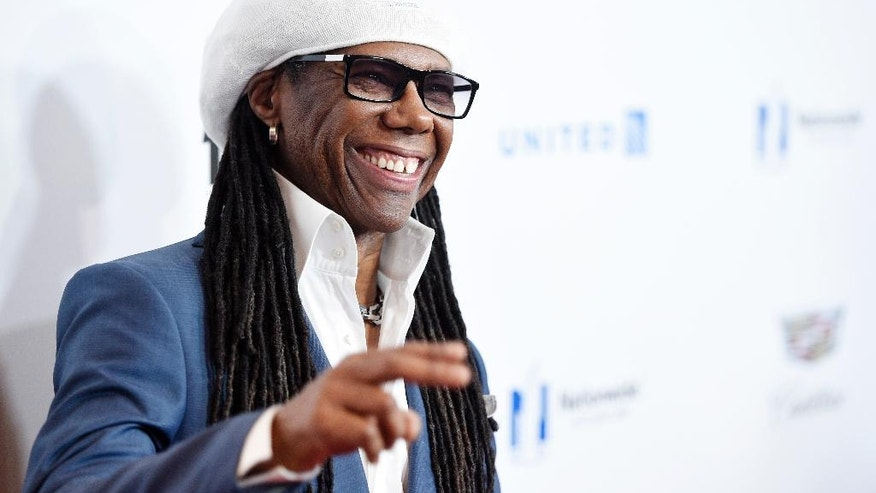 Musician Nile Rodgers reacts to photographers at the 2016 EBONY Power 100 Gala at the Beverly Hilton on Thursday, Dec. 1, 2016, in Beverly Hills, Calif. (Photo by Chris Pizzello/Invision/AP)