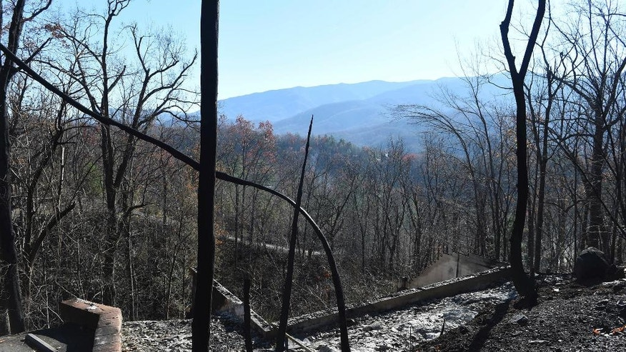 The charred foundation is all that remains of a home in the Cobbly Knob area of Pigeon Forge, Tenn., Thursday, Dec. 1, 2016.   A devastating wildfire destroyed numerous homes and buildings on Monday. (Amy Smotherman Burgess/Knoxville News Sentinel via AP)