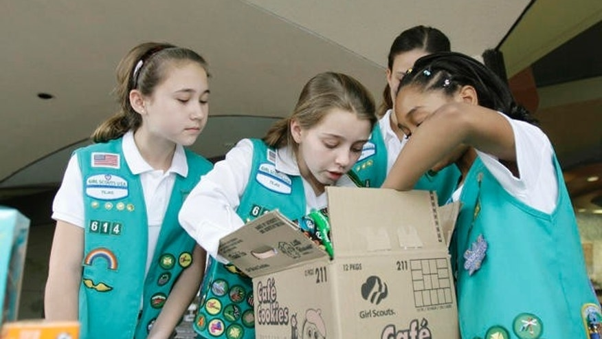 Girl Scouts unpacking boxes filled with cookies to sell