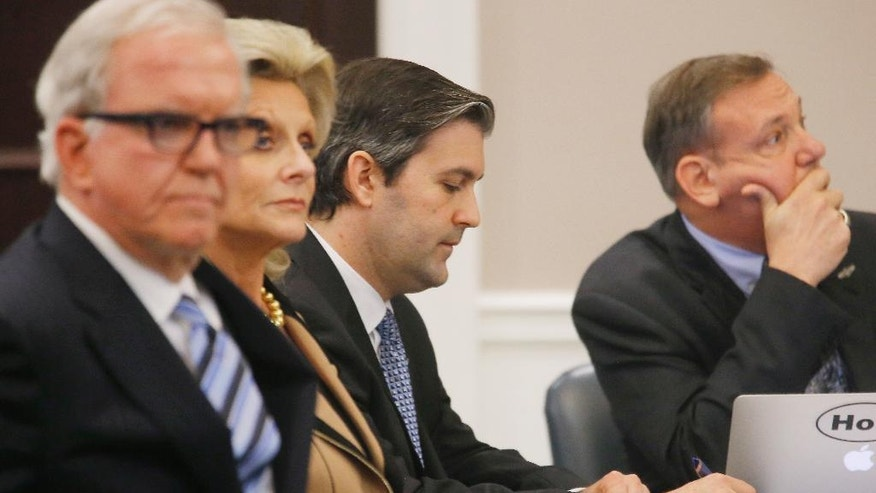 North Charleston police officer Michael Slager, second from right, sits in the courtroom during his murder trial at the Charleston County court in Charleston, S.C., Friday, Dec. 2, 2016, in Charleston, S.C. Circuit Judge Clifton Newman told the jurors Friday afternoon that they should try again to reach a verdict in the trial of former South Carolina patrolman Michael Slager. (Grace Beahm/Post and Courier via AP, Pool)
