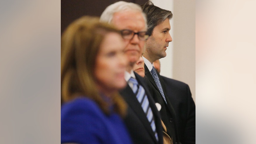 North Charleston police officer Michael Slager, third from left, stands in the courtroom during his murder trial at the Charleston County court in Charleston, S.C., Friday, Dec. 2, 2016, in Charleston, S.C. Circuit Judge Clifton Newman told the jurors Friday afternoon that they should try again to reach a verdict in the trial of former South Carolina patrolman Slager. The jury will continue deliberations Monday. (Grace Beahm/Post and Courier via AP, Pool)