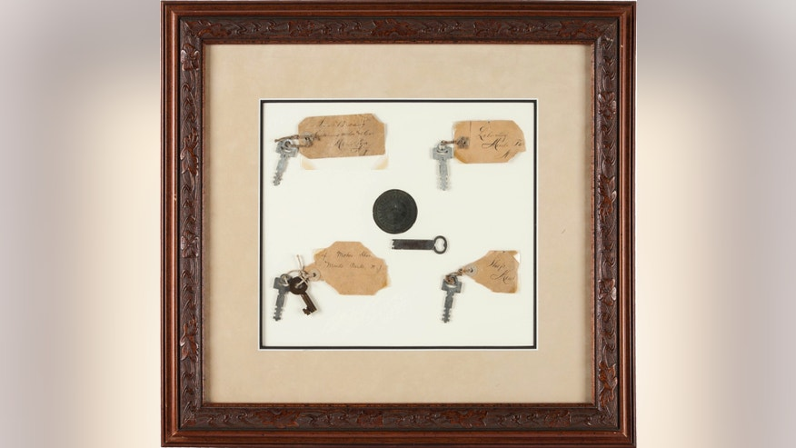 This photo provided by Heritage Auctions shows Thomas A. Edison: Keys to His Menlo Park Laboratory on display. Six keys in all from the famous inventor's Menlo Park home and work place will be auctioned Saturday, Dec. 3, 2016 in Dallas, along with five lightbulbs, including two that he created. Heritage Auctions will open the bidding on the two lots. (Heritage Auctions via AP)
