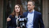 Missouri Gov.-elect Eric Greitens and his wife Sheena speak to the media Tuesday, Dec. 6, 2016, in St. Louis. Sheena Greitens was robbed at gunpoint while sitting in her car on Monday night not far from from the future first family's current St. Louis home. (AP Photo/Jeff Roberson)