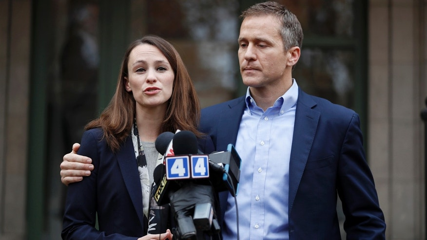 Missouri Gov.-elect Eric Greitens and his wife Sheena speak to the media Tuesday, Dec. 6, 2016, in St. Louis. Sheena Greitens was robbed at gunpoint while sitting in her car on Monday night not far from from the future first family's current St. Louis home.