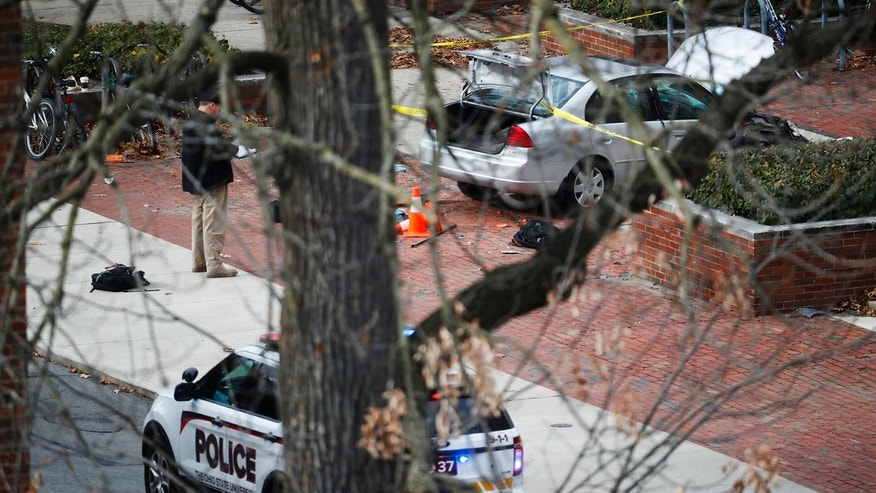 A car inside a police line sits on the sidewalk as authorities respond to an attack on campus at Ohio State University, Monday, Nov. 28, 2016, in Columbus, Ohio.