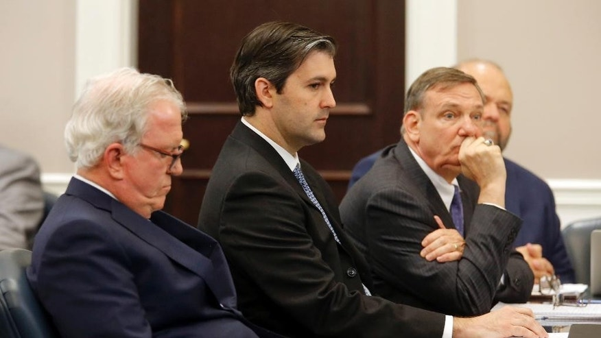 Defense attorneys Andy Savage, left, Don McCune, and Miller Shealy, right, sit around former North Charleston police officer Michael Slager at theCharleston County court in Charleston, S.C., Monday, Dec. 5, 2016. Judge Clifton Newman declared a mistrial after the jury was unable to reach a verdict. Slager was charged in the shooting death of an unarmed black motorist. (Grace Beahm/Post and Courier via AP, Pool)
