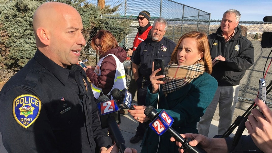 Reno police officer Tim Broadway briefs reporters outside Hug High School on the north side of Reno, Nev., on Wednesday, Dec. 7, 2016 after a Washoe County School District police officer shot a student following a disturbance at the school.
