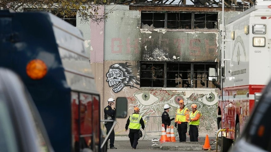 Members of the Alameda County Sheriff's Office stand outside the site of a warehouse fire Wednesday, Dec. 7, 2016, in Oakland, Calif. Recovery efforts at the site have ended officials said Wednesday.  (AP Photo/Eric Risberg)
