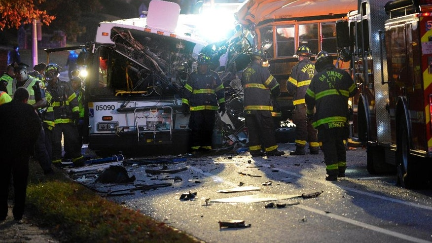 FILE - In this Tuesday, Nov. 1, 2016, file photo, fire department and rescue officials work at the scene of an early morning fatal collision between a school bus and a commuter bus in Baltimore. National investigators said the driver of the Baltimore school bus, Glen Chappell, that careened into a transit bus, killing six people, including himself, was speeding and had a history of crashes and seizures, in its initial report Wednesday, Dec. 7. (Jeffrey F. Bill/The Baltimore Sun via AP, File)