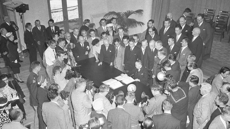 FILE - In this Sept. 8, 1951, file photo, Japan's Prime Minister Shigeru Yoshida signs Security Treaty giving U.S. the right to maintain sea, air and land military bases in and about Japan, in San Francisco. The news media widely reported this week that Shinzo Abe will be the first Japanese prime minister to visit Pearl Harbor when he goes later this month _ but he might not be. A 1951 article in Japan's largest newspaper says that then-Prime Minister Shigeru Yoshida went to Pearl Harbor during a stopover in Hawaii on the way home from San Francisco, where he had signed a peace treaty with the allied powers and other nations. (AP Photo/File)