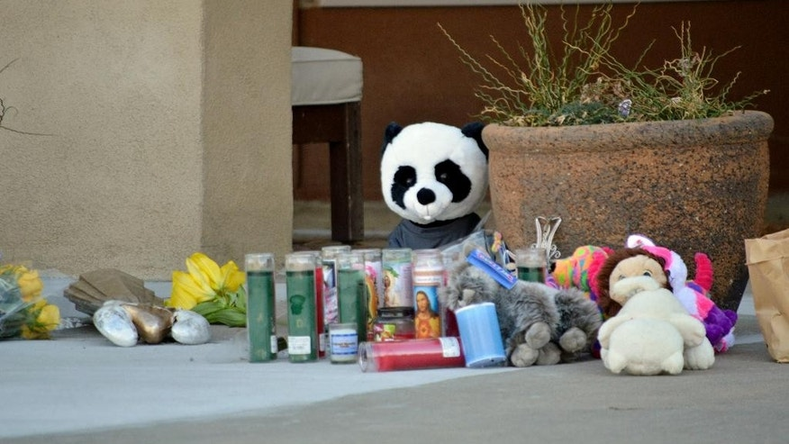 "Candles and stuffed animals left by neighbors rest outside an Albuquerque, N.M., home Wednesday, Dec. 7, 2016, after a deadly shooting. Authorities said George Daniel Wechsler, shot and killed the three children Monday evening as their mother frantically tried to protect them. Wechsle was an Albuquerque native and the brother of one of the stars of ABC's ""Revenge"" television series. (AP Photo/Russell Contreras)"