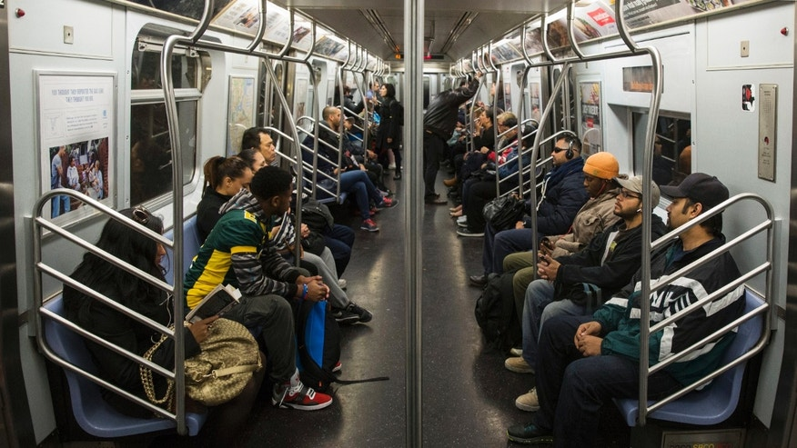 Commuters ride the L train in New York City