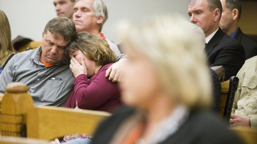Larry Phillips and his wife Kimberly Phillips lean on each other during their son, Sean Phillips', sentencing in the death of his daughter at the Mason County Courthouse in Ludington, Mich., Friday, Dec. 9, 2016. Phillips convicted of second-degree murder in the disappearance of his 4-month-old daughter was sentenced to 19 to 45 years in prison. (Emily Brouwer/Muskegon Chronicle via AP)